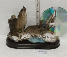 More details for pair of classic brown wolves figurine 1 wolf lying down 1 sitting wolf howling