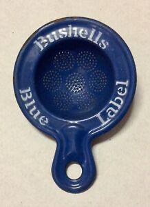 old BUSHELLS BLUE LABEL enamel tea strainer