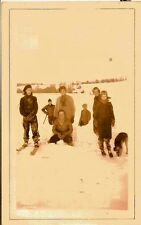 Vintage Antique Photograph People and Puppy Dog in the Snow Skies
