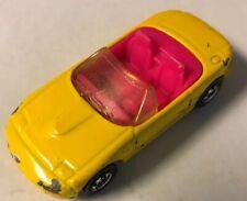 Hot Wheels 1990 ~ Convertible Mazda Miata MX-5 ~ yellow w/pink interior
