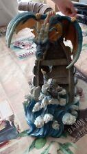 figurine Dragon en résine coloré avec personnage et bateau