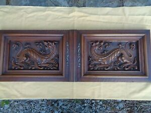 antique french carved wood doors with griffins, walnut