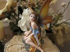 Fairyland Legends Fairy Figurine kneeling on a rock by Pacific Giftware