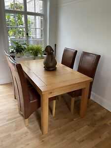 Solid Oak Extendable Dining Table And Four Real Leather Chairs