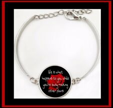 """LIFE IS WHAT HAPPENS TO YOU WHILE YOU'RE BUSY MAKING OTHER PLANS"" BRACELET"