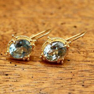 Aurelian Blue Topaz Earrings: Museum of Jewelry