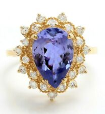 4.18 Carat Natural Tanzanite and Diamonds in 14K Solid Yellow Gold Women's Ring