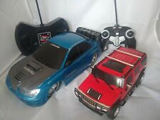 2 Remote Control Cars - Hummer and Subaru - Tested and working