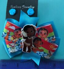 Disney toddler Moana hair bow and sea shell earrings.