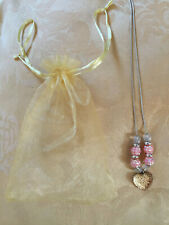 Girls beautiful pink and gold necklace complete with organza display bag - ideal