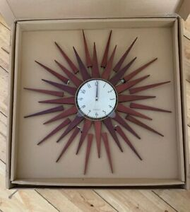 "NEWGATE ""Pluto Clock "" Sunburst Design 67cm Diameter  -(NEW)"