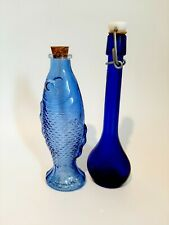 2 SMALL DECORATIVE BLUE GLASS BOTTLES.
