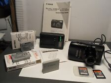 Canon PowerShot SD990IS 14.7MP Digital CAMERA with 3.7 x Optical Image W/ EXTRAS