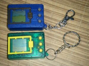 Pair Digimon Electronic Virtual Pet - 1997 Green & Yellow plus 2019 Blue & Grey