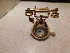 Small heavy Timex quartz clock in a telephone shape with detachable phone