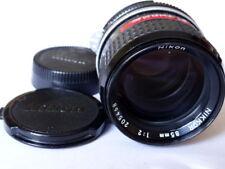 Nikon Nikkor 85mm F2 con caps.