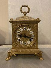 Antico pendolo orologio a lanterna
