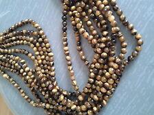 Perles en oeil de tigre 8 mm,  en enfilades, prix pour 1 enfilade.