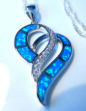 "STUNNING BLUE FIRE OPAL DOUBLE HEART PENDANT + 20"" SILVER CHAIN."