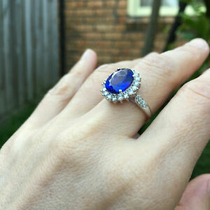 Gorgeous 1.258CTs Natural AAAAA Tanzanite W/diamonds 18K Gold ring KG94