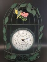 Eleco Wrought Iron Wall Clock. Working condition. Ceramic Hummingbird attached.