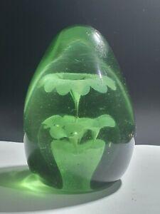 VICTORIAN BOTTLE GREEN GLASS DUMP PAPERWEIGHT WITH INTERNAL BUBBLE FLOWERS
