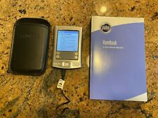 Palm Tungsten E Hand Held Organizer has stylus and charger.