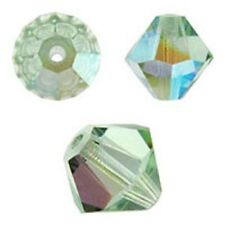 Swarovski Crystal Bicone. Chrysolite AB Color. 6mm. Approx. 48 PCS. 5328