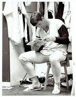 1979 Vintage Photo NY Yankees pitcher Tommy John reads fan mail in locker room