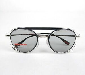 Prada Shiny Clear Plastic Round Sunglasses with Silver Metal Legs SPS50T