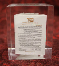 Lucite Acrylic Security Spring and Boe Annual Report Paper Weight.