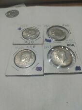 Four 40 Percent Silver Kennedy Half Dollars
