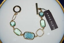 DELICATE NEW ANNE KLEIN BRACELET OF GOLD TONED METAL WITH BLUE & GREEN CRYSTALS