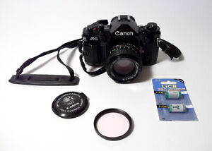 MINT Canon A-1 35mm Film Black Body Camera with FD 50mm f/1.4 Lens