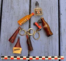 Lot de 7 porte-clés anciens auxquels il manque l'anneau ou l'étiquette...