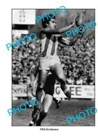 8x6 PHOTO NORTH MELBOURNE FC GREAT PHIL KRAKOUER IN ACTION