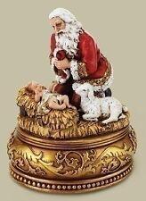 CHRISTMAS DECORATIONS - KNEELING SANTA AND BABY JESUS MUSIC BOX