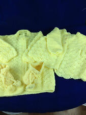 yellow hand crocheted two sweater and bootties baby or life sized porcelain doll