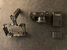 Sony Alpha α6000 Mirrorless Camera, Lens, Rig Cage, Extra Battery