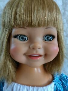 1960'S GIGGLES DOLL AND SHE STILL GIGGLES AND WIGGLES