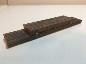 Ladegut Stahlstangen auf Kanthölzern - 1116 von Redscale