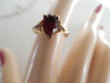 VINTAGE AVON GOLD TONE RING WITH A RED TEAR DROP STONE AND 2 CLEAR RHINESTONES