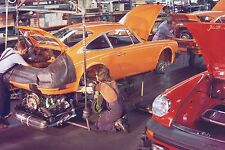 Porsche 911 2.7 building engine in bodywork at 1970s Porsche factory –photograph