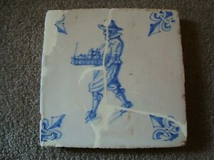 17th Century Delft blue depicting a figure carrying items in a basket  21/354B