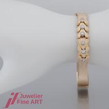 Armreif - mit 6 Brillanten (Diamant) ges. ca. 0,30ct - 14K/585 Gelbgold-Weißgold