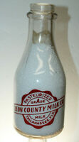 TALLAHASSEE FLA LEON COUNTY MILK CO MILK BOTTLE WAR SLOGAN QUART NICE !!
