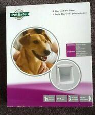 NEW IN BOX. PETSAFE PET DOOR FOR MEDIUM SIZE DOG. CHARITY SALE