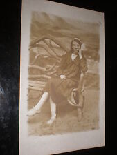 Old postcard woman seated on bench c1920s