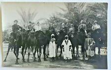 Vintage RPPC Biskra (Algeria) Tour Group, Camels 1920's; photographer noted.