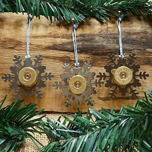 Beautiful shiny metal snowflakes with used shotgun cartridge brass comes boxed